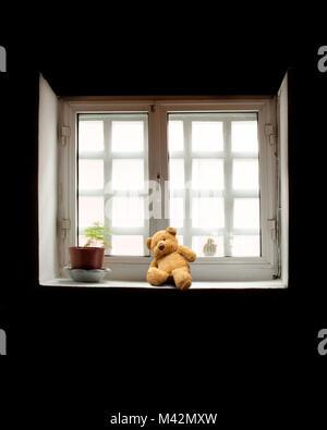 Teddy Bear on Windowsill - Stock Photo