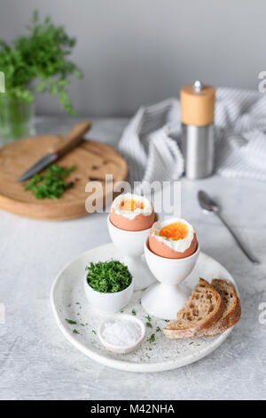 Soft boiled eggs and toasts for breakfast on cocnrete background. Selective focus. Healthy eating, healthy lifestyle - Stock Photo