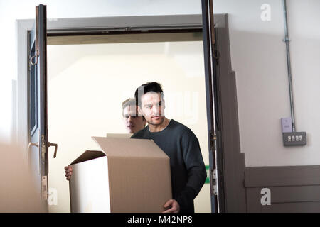 Young male couple moving home