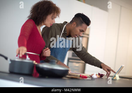Adult male preparing using digital tablet - Stock Photo