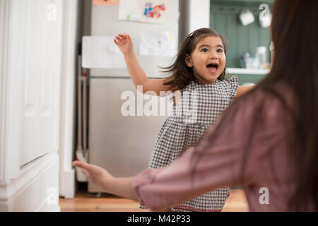 Girl running into mother's arms - Stock Photo