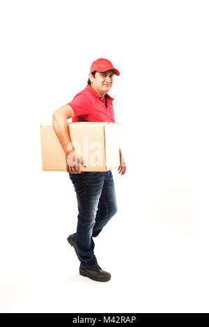 Delivery Concept - Portrait of Happy Indian or delivery man in red or green uniform walking or jumping or checking - Stock Photo