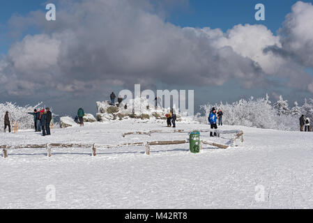 Tourists on the plateau of Feldberg Taunus in winter, Hesse, Germany - Stock Photo