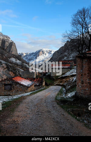 The beautiful road of the village of Vegas del Toro, near Sotres, after a slight late spring snowfall, sotres, bulnes, - Stock Photo