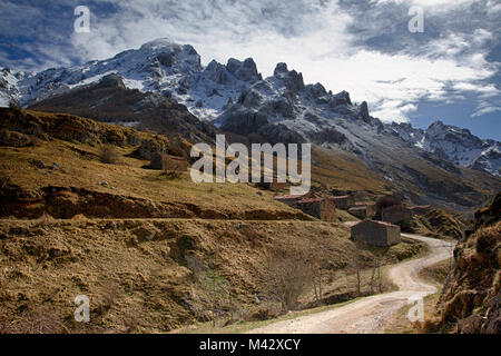 A beautiful road of the village of Vegas del Toro, near Sotres, after a slight late spring snowfall, sotres, bulnes, - Stock Photo