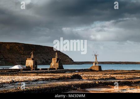 Mills in the Salinas de Janubio, Yaiza, Lanzarote, Canary Islands, Spain - Stock Photo