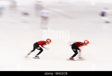 Gangneung, South Korea. 14th Nov, 2017. Team China warms up during the Men's Short Track Speed Skating 5000m Heat - Stock Photo