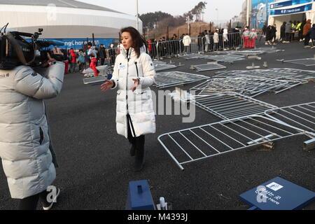 Gangneung, South Korea. 14th Feb, 2018. GANGNEUNG, SOUTH KOREA - FEBRUARY 14, 2018: A reporter in Gangneung Olympic - Stock Photo