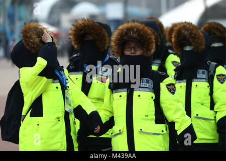 Gangneung, South Korea. 14th Feb, 2018. GANGNEUNG, SOUTH KOREA - FEBRUARY 14, 2018: Police officers in Gangneung - Stock Photo