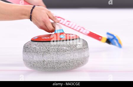 Gangneung, South Korea. 14th February, 2018. Olympic stone. Mens curling. Gangneung curling centre. Gangneung Olympic - Stock Photo