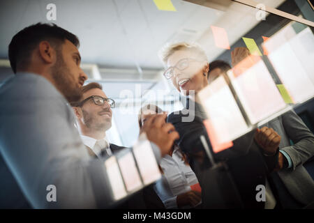 Business people planning strategy in office together - Stock Photo