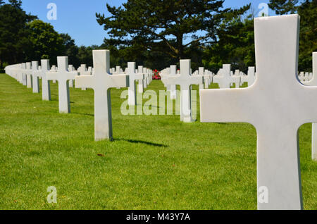 American military cemetery at Colleville-su-Mer, France. Rear view of white crosses of US soldiers killed during - Stock Photo