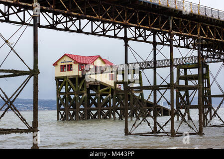Old Mumbles Lifeboat Station from underneath Mumbles Pier - Stock Photo
