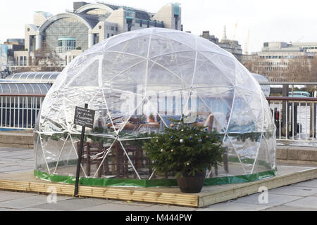 igloo-style PVC party-domes on the banks of the Thames London - Stock Photo