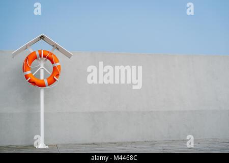 Orange lifebuoy on the pier - Stock Photo
