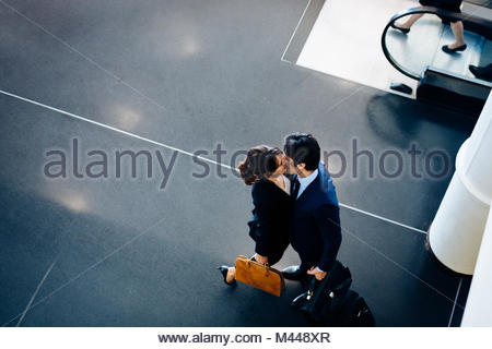 Couple in business suits kissing - Stock Photo