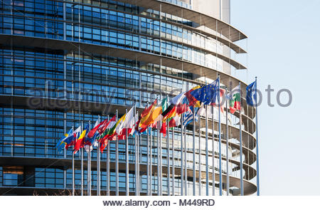 All European Union flags in front of parliament eu - Stock Photo