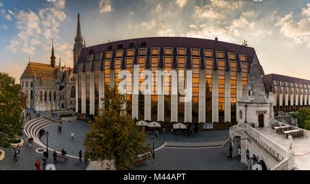 Modern facade of the Hilton Hotel with Mathias Church and Fisherman's Bastion,Budapest,Hungary - Stock Photo