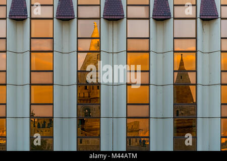 Modern facade of the Hilton Hotel with reflection of the Mathias Church,Budapest,Hungary - Stock Photo