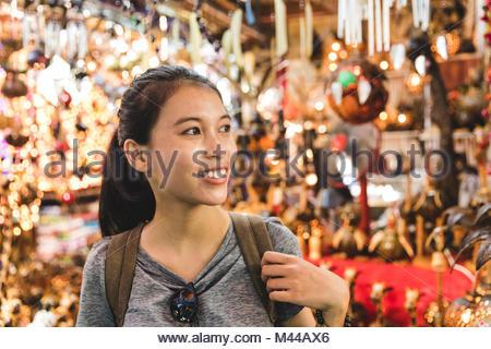 Tourist walking in bazaar, Bangkok, Thailand - Stock Photo