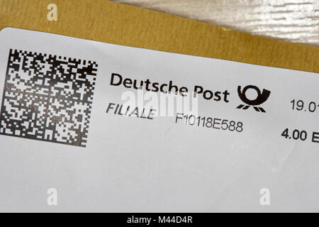 deutsche post printed stamp including qr code on a package posted in germany - Stock Photo