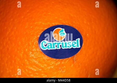 sticker on a valencia orange from carrusel company spain - Stock Photo