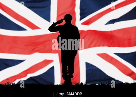Silhouette Of A Solider Saluting In Front Of The British Flag - Stock Photo