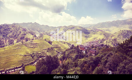 Longji Rice terraces (Dragons Backbone) in Longsheng County, retro color toning applied, China. - Stock Photo
