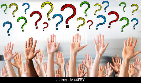 Digital composite image of multicolored question marks above business people's hands - Stock Photo