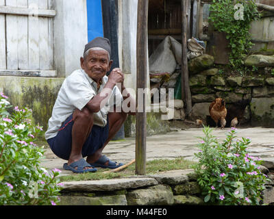 Bahundanda, Nepal, september 6, 2015: Old Nepalese man sitting on the floor - Stock Photo