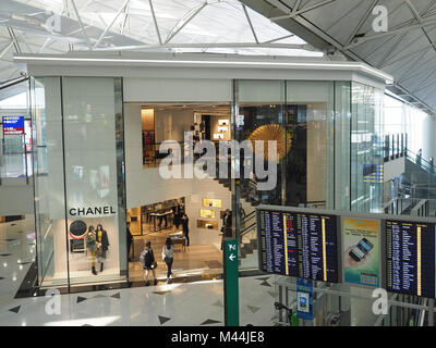 View of the Chanel shop in the departure area of Hong Kong International airport - Stock Photo