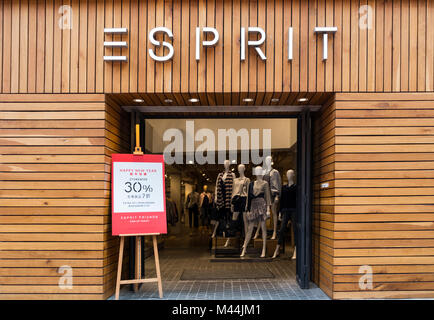 Hong Kong - February 11, 2018: Esprit shop in Hong Kong. Esprit is a manufacturer of clothing, footwear, accessories, - Stock Photo