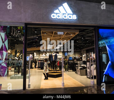 Hong Kong - February 11, 2018: Adidas store in Hong Kong. Adidas is a German corporation, the largest sportswear - Stock Photo