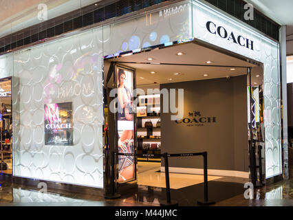Hong Kong - February 11, 2018: Coach shop in Hong Kong. Coach, Inc. is an multinational luxury fashion company based - Stock Photo