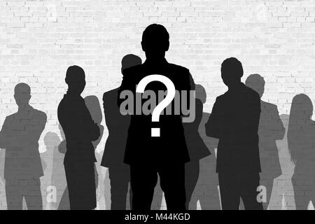 Question mark on silhouette businessman standing in front of colleagues against wall - Stock Photo