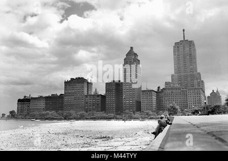 View from Oak Street Beach looking south towards Streeterville neighborhood on the north side of Chicago, ca. 1958. - Stock Photo
