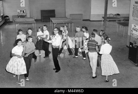 1960s Historical Boys And Girls In A Classroom At