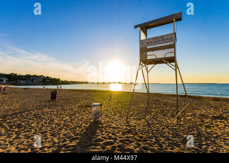 Backlit lifeguard tower at sunset in the Grande Plage beach at Saint-Jean-de-Luz, Aquitaine, France - Stock Photo