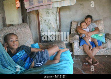 A mum and her 2 young children at home, Rakiraki, Fiji.