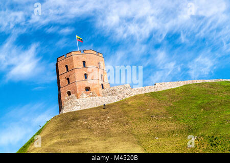 Gediminas tower (Gedimino) in Vilnius, Lithuania. Partly cloudy sky on a summer day. Famous tourist attraction in - Stock Photo