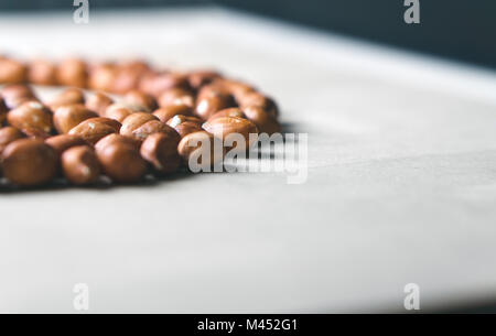 Peanuts on wooden table. Bunch of nuts. Group of groundnuts. Free empty copy space for text. - Stock Photo