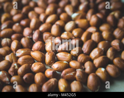 Close up to many peanuts. Bunch of nuts. Group of groundnuts. Shallow depth of field and old retro vintage filter - Stock Photo