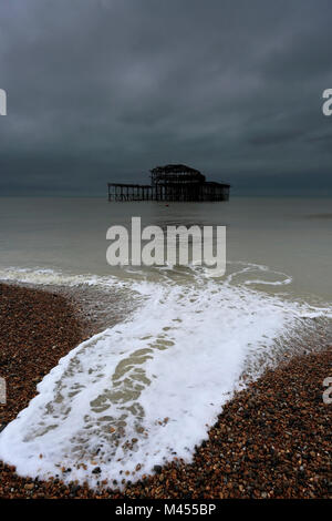 Dramatic skies over the ruined West pier, Brighton & Hove, East Sussex, England, UK - Stock Photo