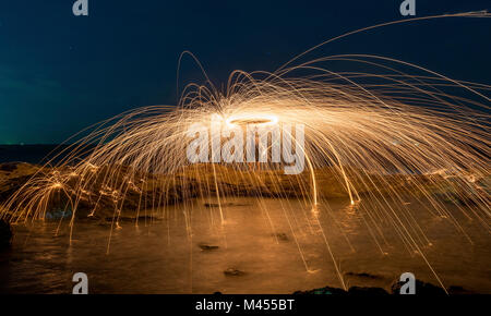 Amazing steel wool coast the sea on the beach in sunset time. - Stock Photo