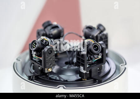 Inner details of 360 surveillance camera.  4 camera in 1 body with open lid. CCTV maintenance and service - Stock Photo