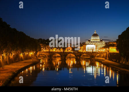 Night view of St. Peter's Basilica. Ponte Sant Angelo and Tiber River in Rome - Italy. Dramatic sunset with sbeautiful - Stock Photo