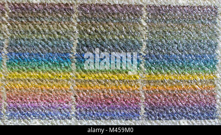 Abstract background of colorful behind the acrylic plate with seamless pattern. Close up of vertical colorful pattern. - Stock Photo