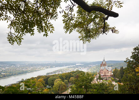 Castle Drachenburg (Schloss Drachenburg) at the Drachenfels near Koenigswinter in Germany with view over the Rhine - Stock Photo