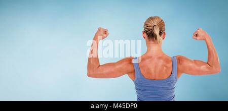 Composite image of rear view of woman flexing muscles - Stock Photo