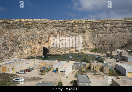 A small bay, reachable through a tunnel in the cliff near the Azure Window in Dwejra, Gozo, Malta. - Stock Photo